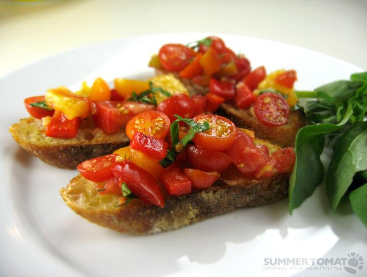 Bruschetta de tomatitos y albahaca