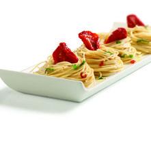 Spaghetti con tomate deshidratado